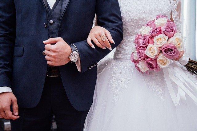couple holding hands in front of the camera